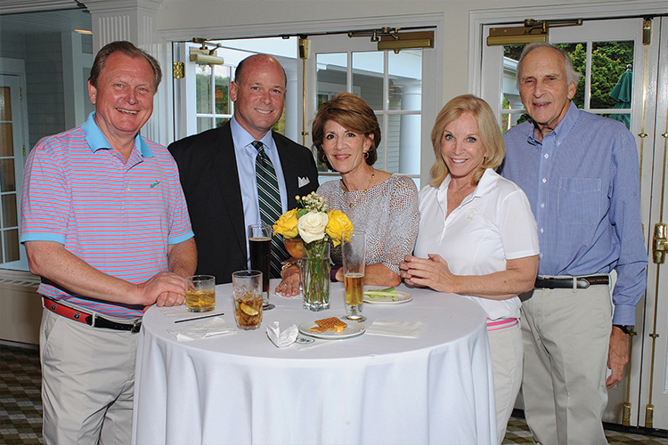 A moment shared for a cause! Ed Tonnessen of JLL, Jonathan Mills of Cummings & Lockwood, Louise Berkman, RFR Realty's Margaret Carlson and Jerome Berkman, SilverSource Board Member