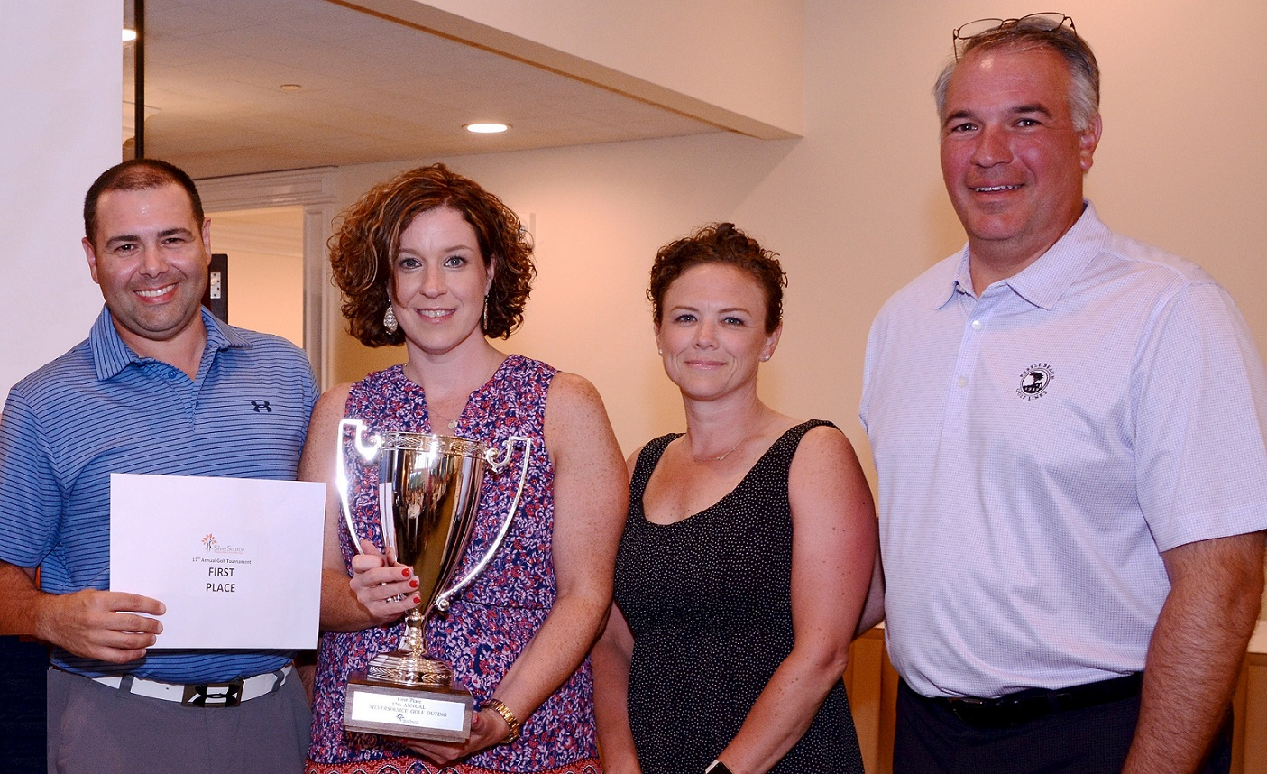 First Place Tournament Winners: KPMG Stamford, left to right: Lou Cosentino, Mary Grande, Hope Cahoon and Ken Seel.