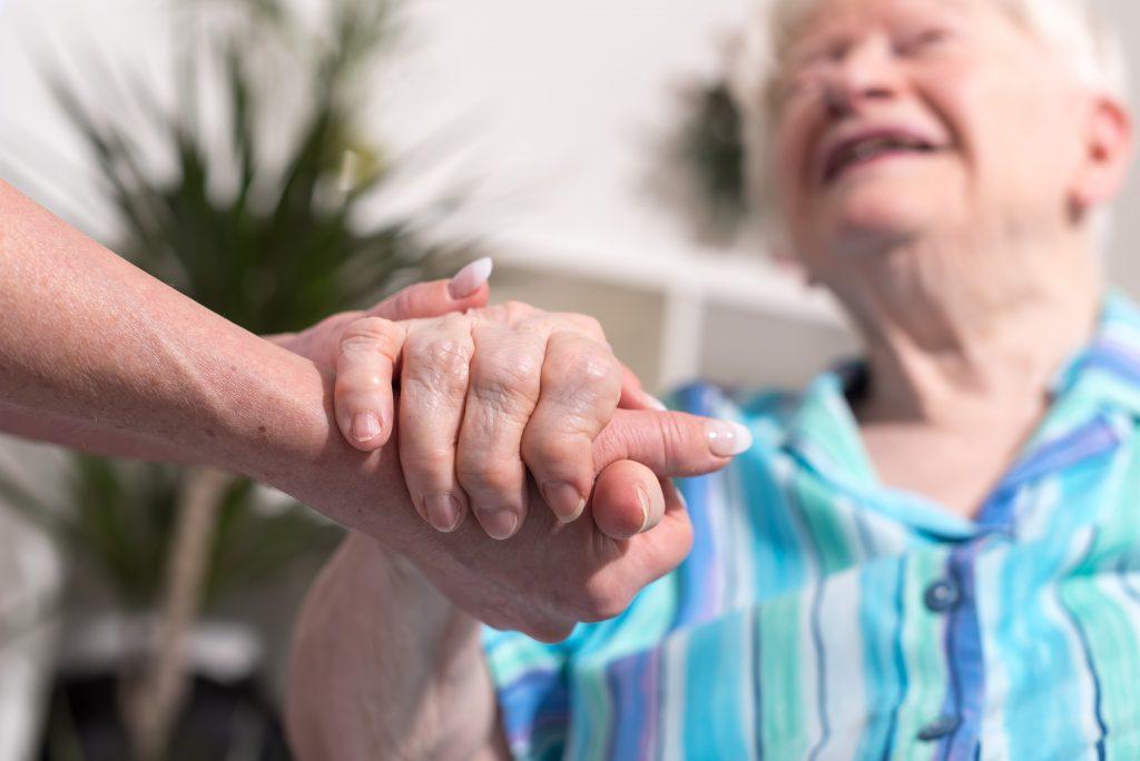 helping senior woman
